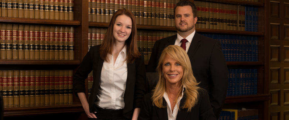 Attorneys Catherine Z. Mackey, T.R. Smith and Assistant Lyndsey Stortz